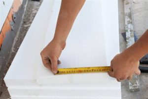 Louisville Home Inspection a man measuring